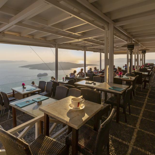 """View of restaurant overlooking Mediteranean Sea, Fira, Firostefani, Santorini (Thira), Cyclades Islands, Greek Islands, Greece, Europe"" stock image"