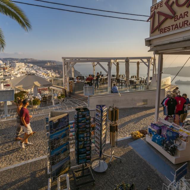 """View of restaurants and shops overlooking Mediteranean Sea, Fira, Firostefani, Santorini (Thira), Cyclades Islands, Greek Islands, Greece, Europe"" stock image"
