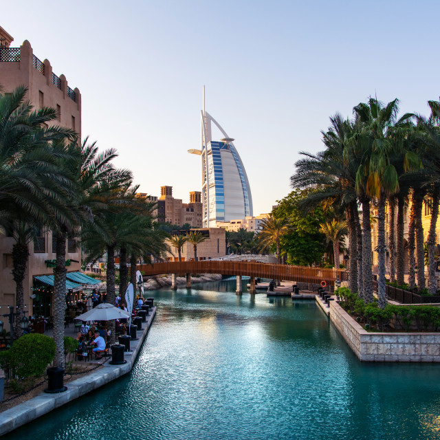 """Burj al Arab and Madinat Jumeirah resort and restaurants in Dubai at sunset"" stock image"