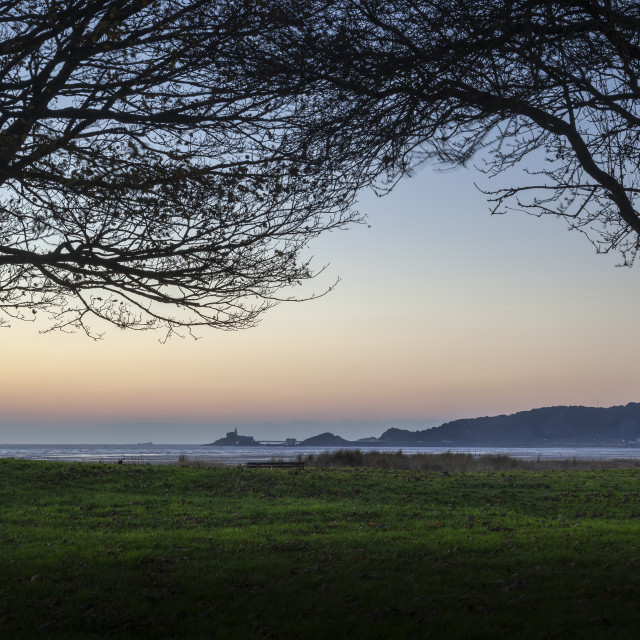 """Dawn at Mumbles headland"" stock image"