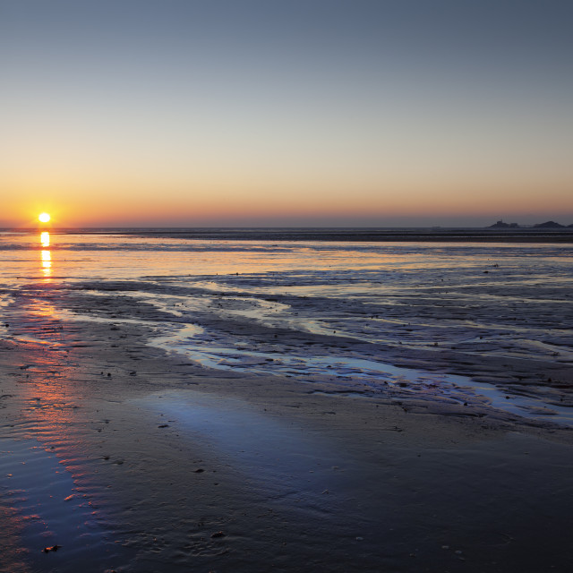 """Sunrise over Swansea Bay"" stock image"