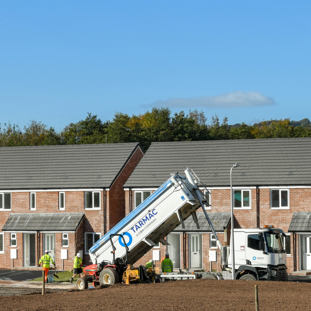 """""""Lorry truck delivering tarmac to a building site"""" stock image"""
