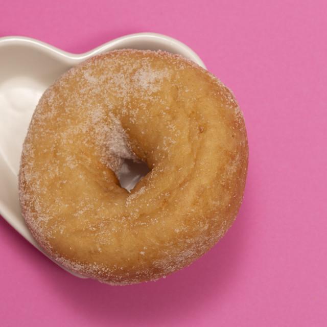 """sugar coated doughnut in a heart shaped dish"" stock image"