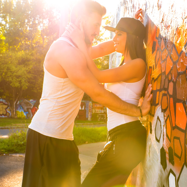 """Young HipHop Couple hugging in a urban environment"" stock image"