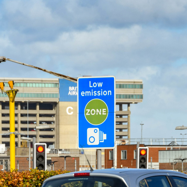 """""""Car passing a Low Emission zone sign."""" stock image"""