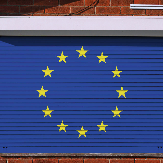 """""""European flag on closed security shutters"""" stock image"""