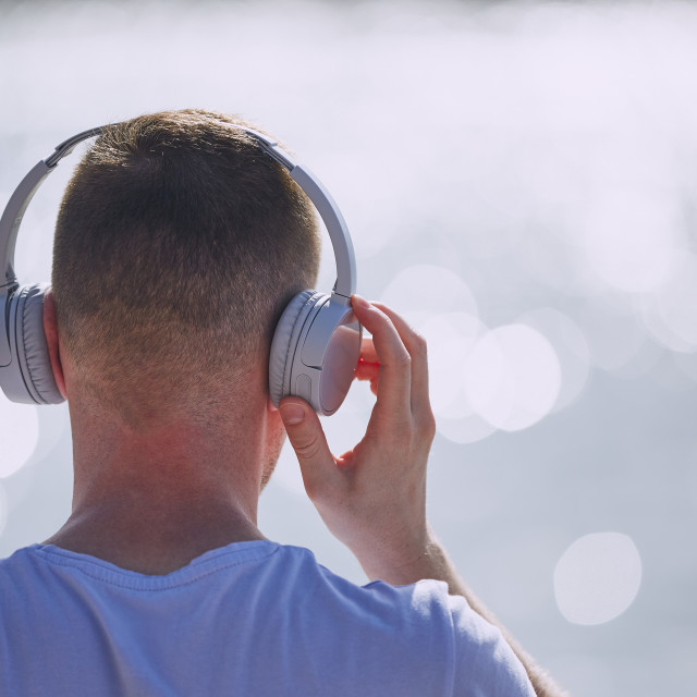 """""""Young man with headphones listening"""" stock image"""