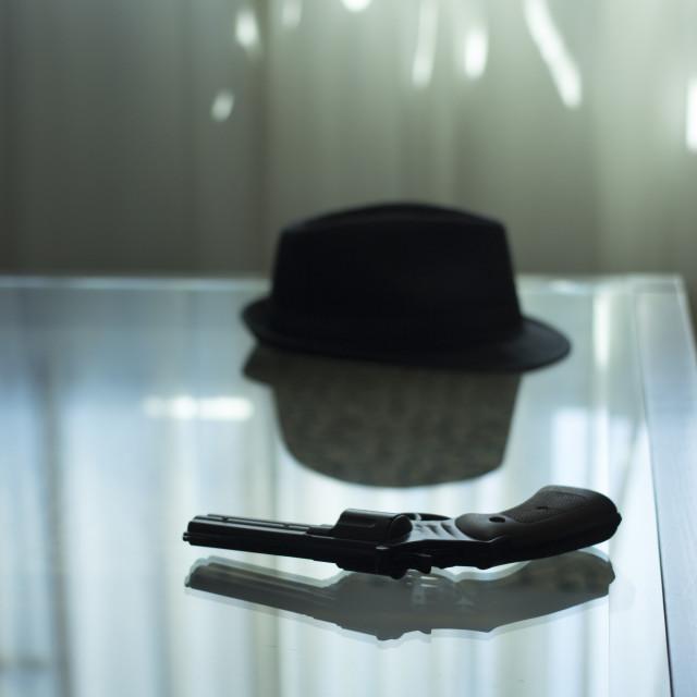 """Pistol gun on table in room"" stock image"
