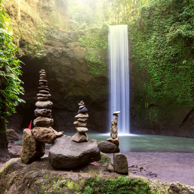 """Stacked zen stone at Tibumana Waterfall in Ubud Bali Indonesia."" stock image"