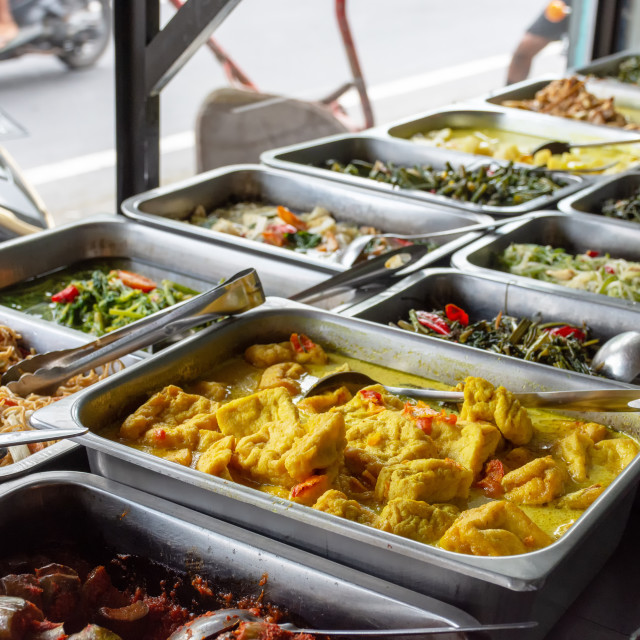 """Indonesian food buffet dishes"" stock image"