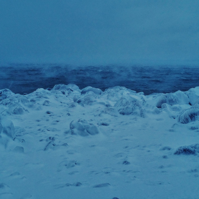 """""""raging sea during a strong winter storm with ice covered shore"""" stock image"""