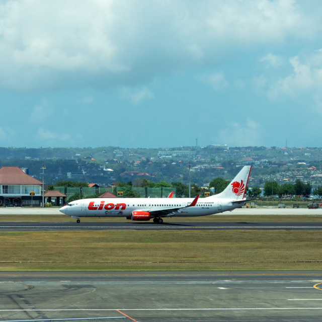 """Lion Air airplane landed at Ngurah Rai International Airport"" stock image"