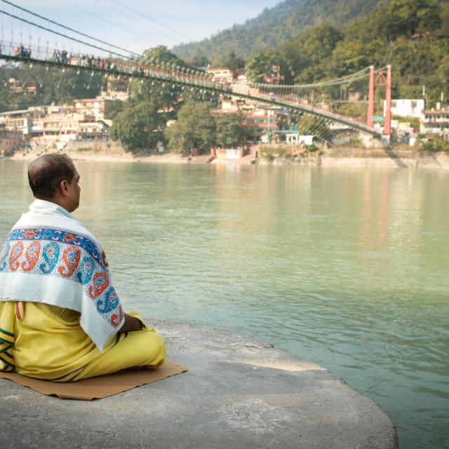 """Meditating alongside the Ganges"" stock image"