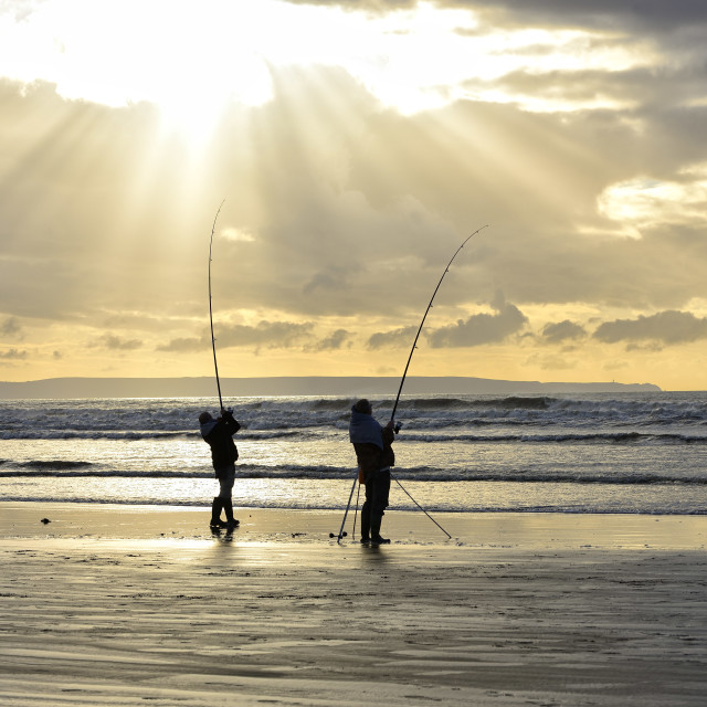 """Fishing off the beach"" stock image"