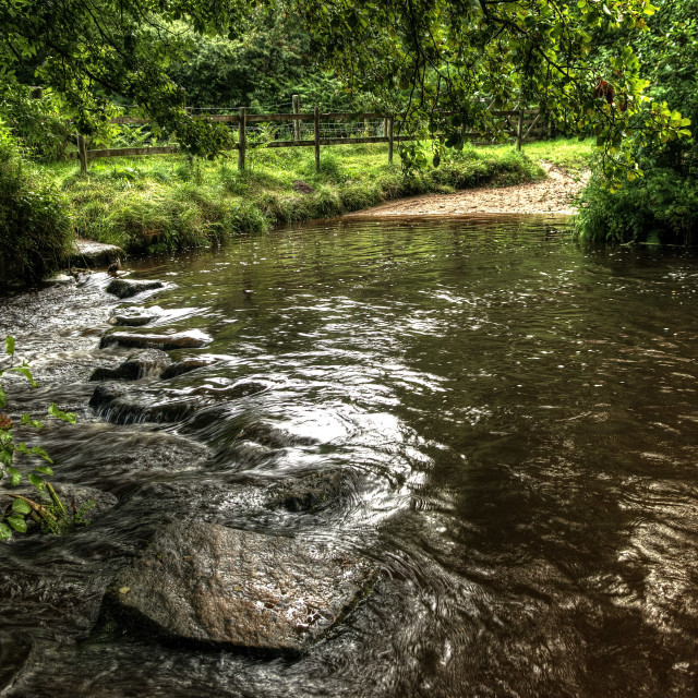 """Stepping stones across the River Bovey in summer rain."" stock image"