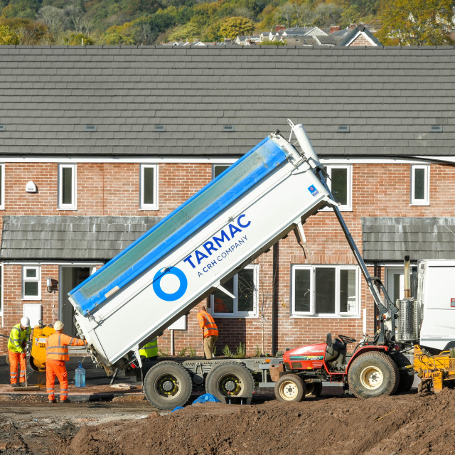 """""""Heavy tipper truck delivering tarmac to a building site"""" stock image"""