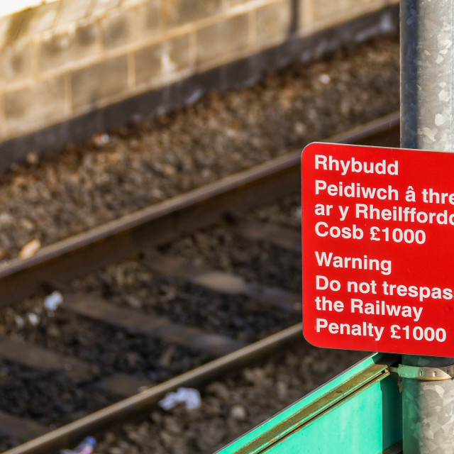 """Close up view of a warning sign at a railway station"" stock image"