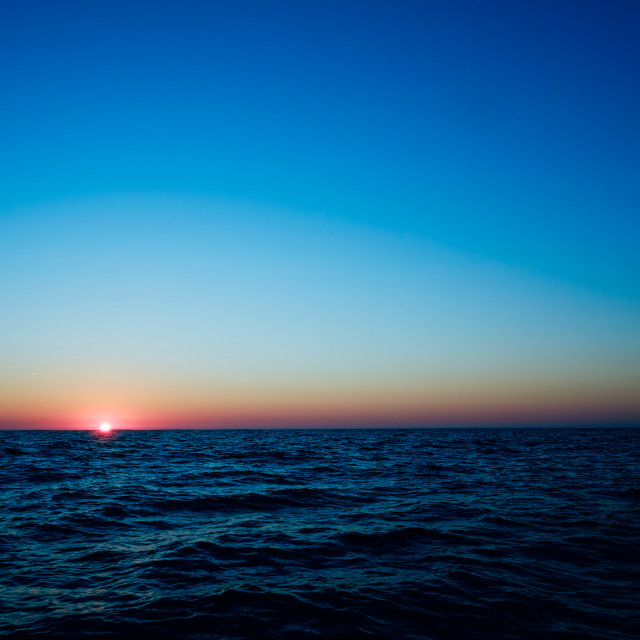 """""""sunrise above the portugal coast from a boat far out at sea at the atlantic ocean"""" stock image"""