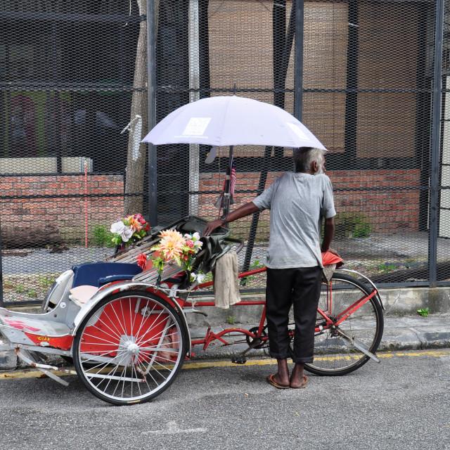 """Trishaw rider"" stock image"