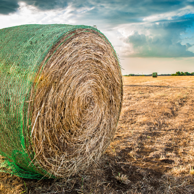 """""""Hay Bale and Approaching Storm"""" stock image"""