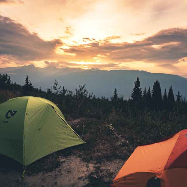 """Tenting over a Revelstoke Sunrise"" stock image"