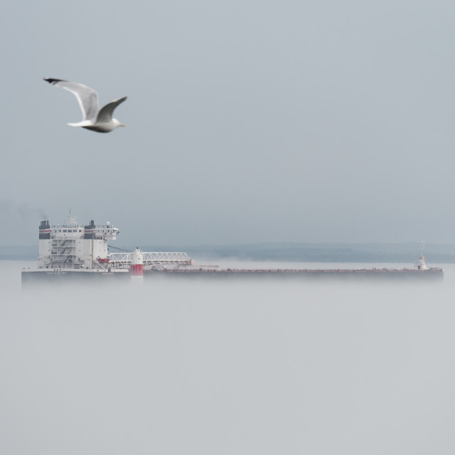 """Great Lakes Freighter Navigating the Fog"" stock image"