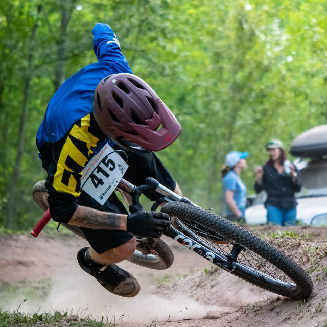 """Biker crashing out of a dual slalom race"" stock image"