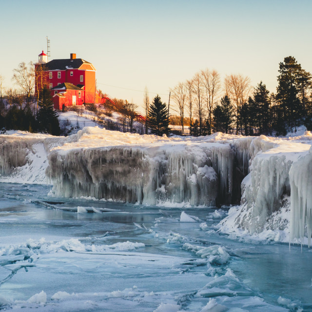 """Marquette Lighthouse on a Frozen Lake Superior"" stock image"