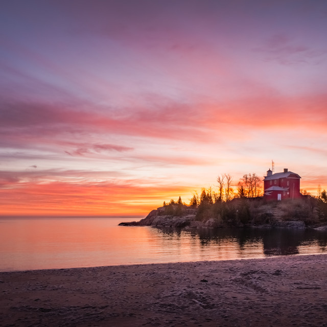 """Lake Superiro Sunrise over Lighthouse"" stock image"