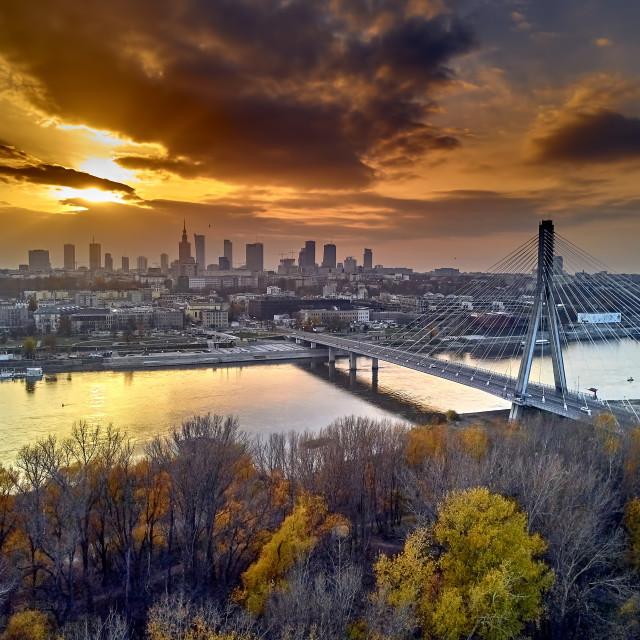 """Beautiful panoramic aerial dsron view to Swietokrzyski Bridge (Polish: most Swietokrzyski, English: Holy Cross Bridge) - is a bridge over the Vistula river in Warsaw, Poland, from dron DJI Mavic Air"" stock image"