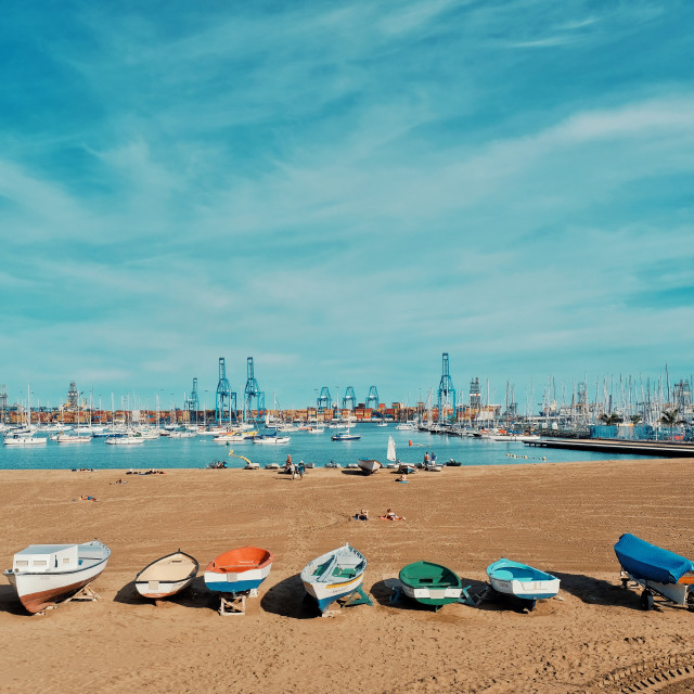 """""""one of the city sandy beaches next to the harbor and marina with sailing yacht boats anchoring in the small bay and fishing dinghies"""" stock image"""