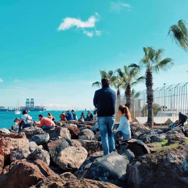 """spectators crowd people gather to watch the atlantic ocean crossing sail boat regatta race ARC 2018"" stock image"