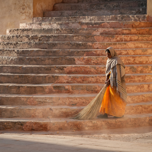 """Woman sweeping steps at Amber Palace"" stock image"