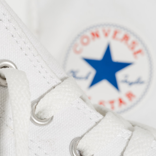 """White Converse Sneakers on White Desk"" stock image"