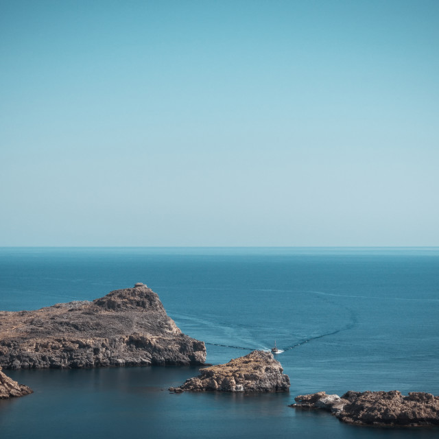 """""""Small rocks go from sea next to Lindos town on Rhodes"""" stock image"""