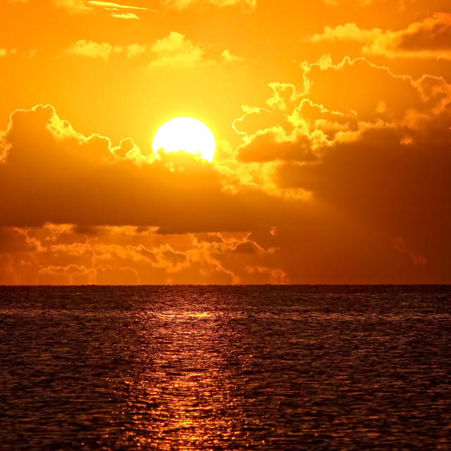 """""""Tropical Sunset in the Florida Keys Sun Setting Over Gulf of Mexico"""" stock image"""