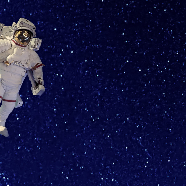 """""""Astronaut in Spacesuit Floating in Space Against Background of Stars"""" stock image"""