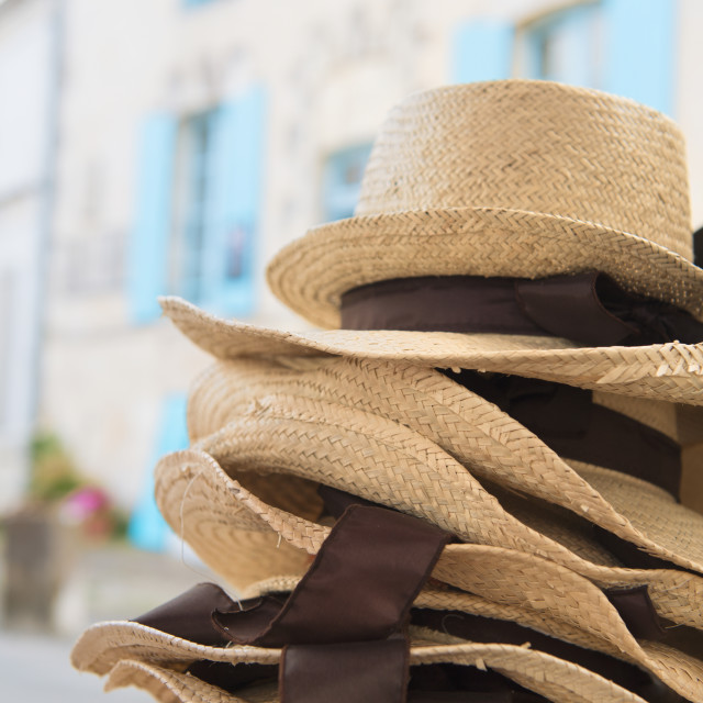 """Stacked straw hats in France"" stock image"