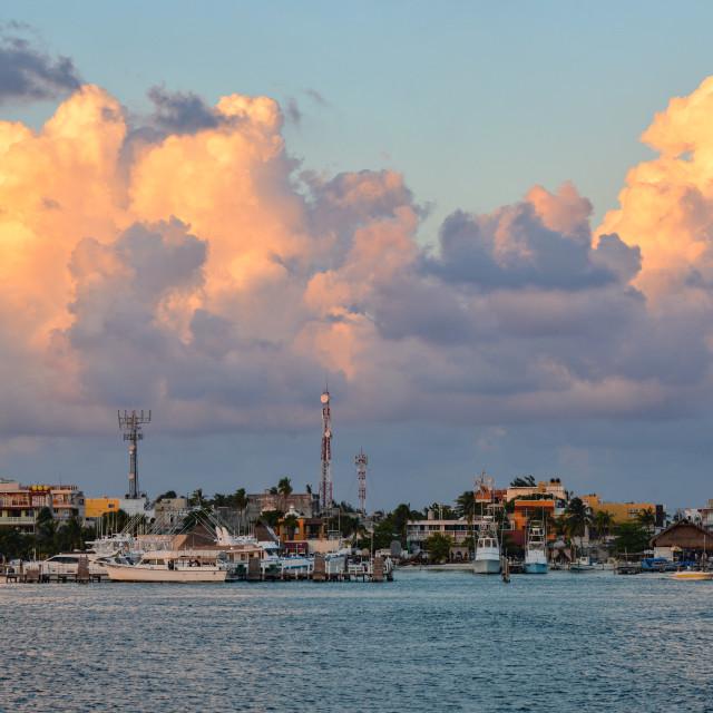 """Dramatic clouds and marina - Isla Mujeres"" stock image"