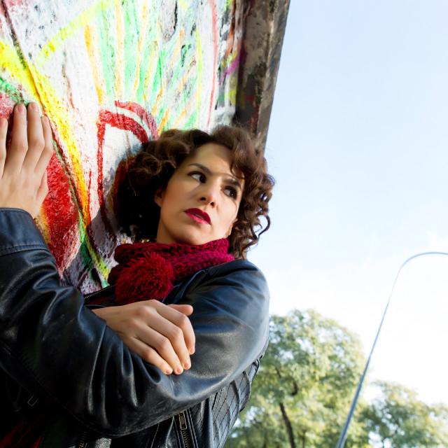 """Beautiful woman posing with graffiti head"" stock image"