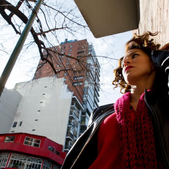 """Pretty woman waiting at graffiti wall"" stock image"