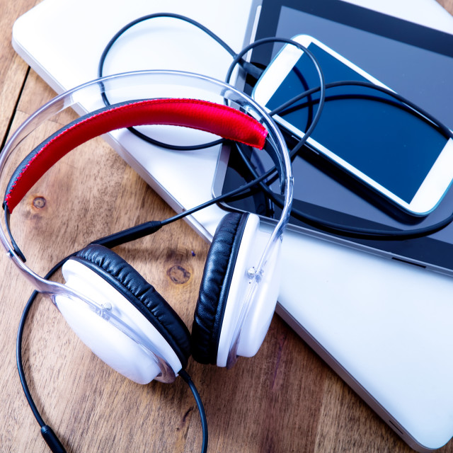 """""""Digital devices and Headphones on a wooden Desktop"""" stock image"""