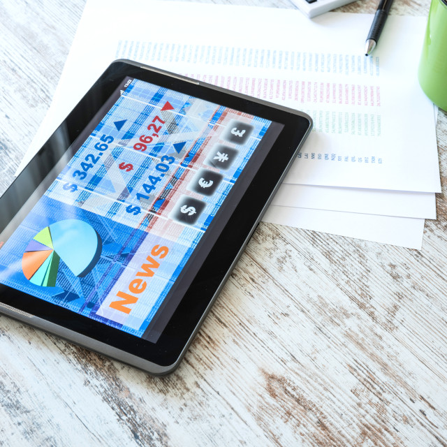 """Stock market trading app on a Tablet PC"" stock image"