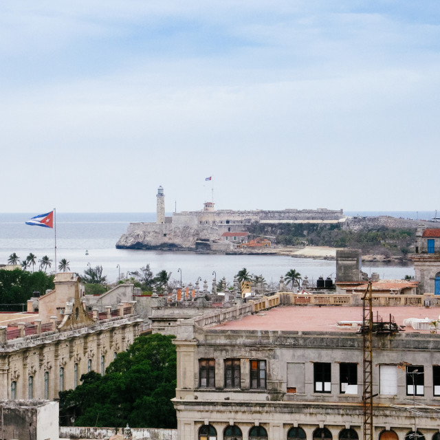"""View of the lighthouse (faro) of Castillio del Morro from the ol"" stock image"