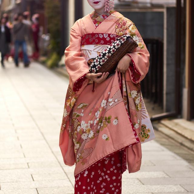 """Geisha wearing a kimono in Gion, Kyoto."" stock image"