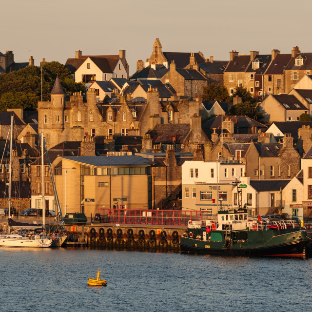 """""""Lerwick, capital, from the sea, waterfront sandstone buildings, golden early..."""" stock image"""