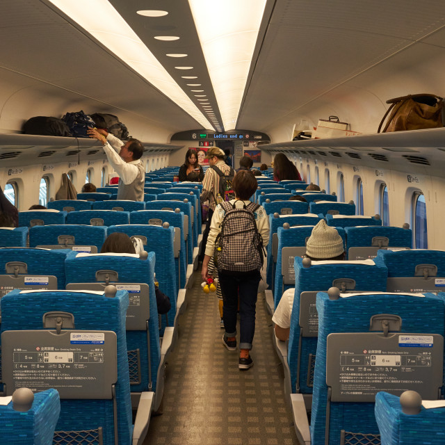 """Passengers on a bullet train in Japan."" stock image"