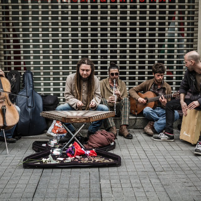 """Street Musicians Performing with their Instruments"" stock image"