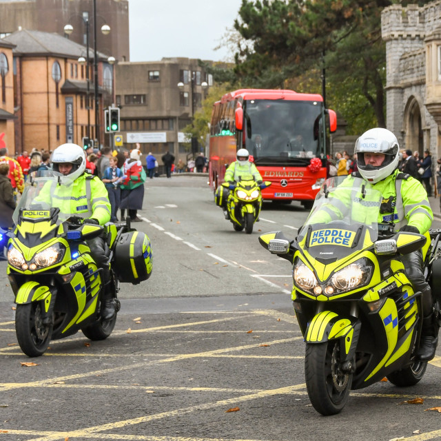 """""""Police motorcycle outriders escorting the Welsh Rugby team bus"""" stock image"""