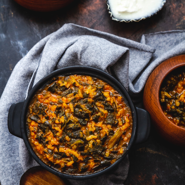 """Spinach Stew with Rice in Black Pot"" stock image"